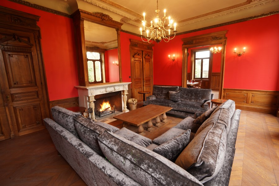 Red sitting room at Chateau d'Hallines