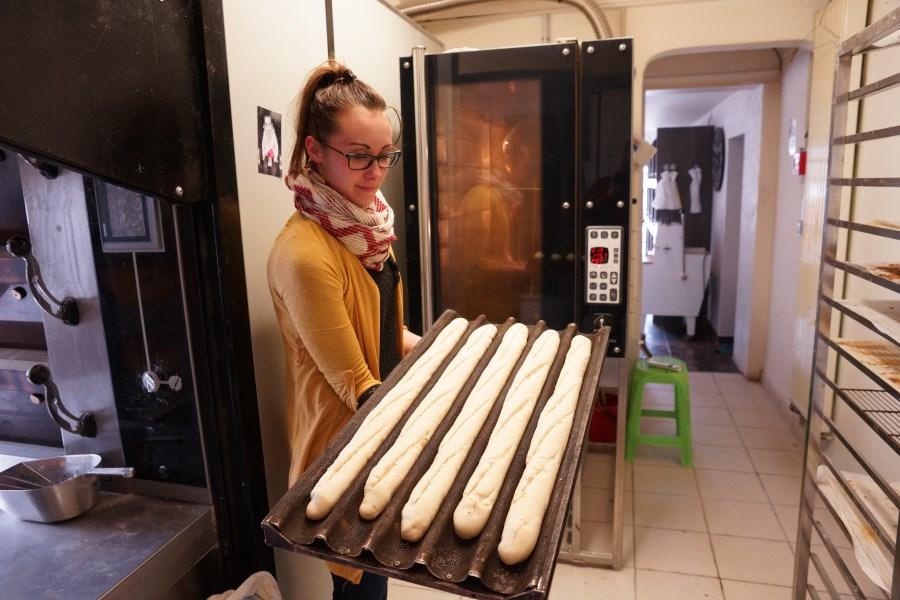 Perrine feeding the bakery oven